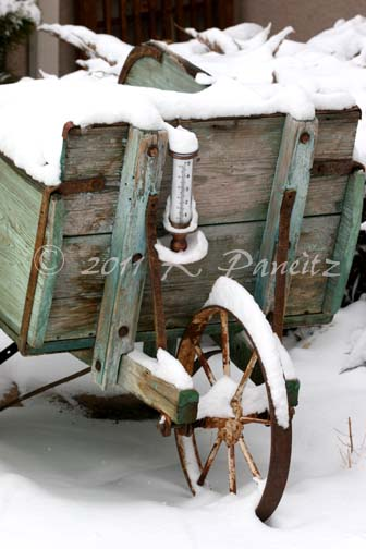 Snowy vintage wheelbarrow